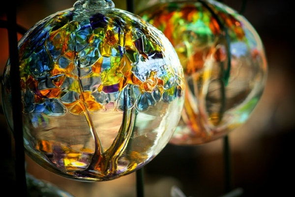 Kitras Art Glass - Stephen Kitras began working as a glass blower in 1988. He studied at Sheridan College located in Oakville, Ontario Canada. For five years he worked alone handling all of the production and administrative tasks. He and his wife Elke were shipping the product from their dinning room table. In 1994 Kitras Art Glass was formed and Stephen and Elke became founding partners of the corporation. At this time, the single most important factor in the company's growth was the beginning of exportation to the United States.By 2001 company sales had increased and a new facility was built to accomodate the increased production demands. In 2006 Stephen and Elke's oldest daughter, Sophie, joined the company and is now the sales and marketing manager. Stephen continues to be involved in the company, overseeing all new product development,training of new staff, and when he has time, working on his own art projects and commissions.In 1999, the company suffered the loss of Elke Kitras to Leukemia, but the vision that she and Stephen developed for the company continues to thrive.It is the vision of Kitras Art Glass to be recoginized as an excellent Canadian glass blowing studio that produces innovative, beautiful and decorative glass objects. We strive to create designs that enhance the modern home, garden and lifestyle. We believe that beautiful things enhance the enjoyment of everyday life. When surrounded by beauty the spirit is uplifted.We hope that you will be inspired by our products, our vision and our passion and share our message with your customers or in your own home.