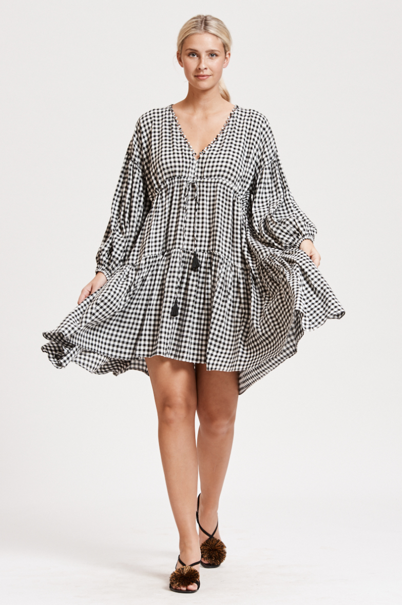 The Gingham Billow Sleeve dress was my investment dress last Summer, and I absolutely loved living in this dress most days. It's super comfy while also being stylish and most shoes go with it! Find it  here.  $189.00
