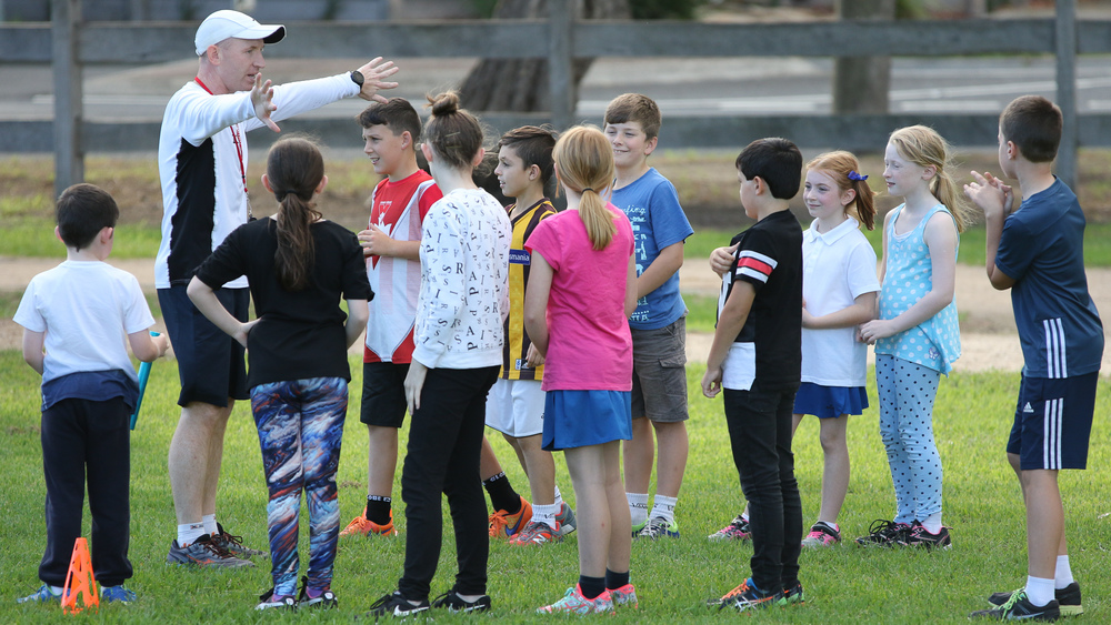 Coach Jim running a clinic with primary school kids