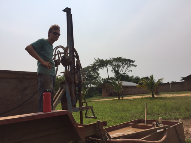 Chris at Work Drilling a New Well at Our CFM Mission