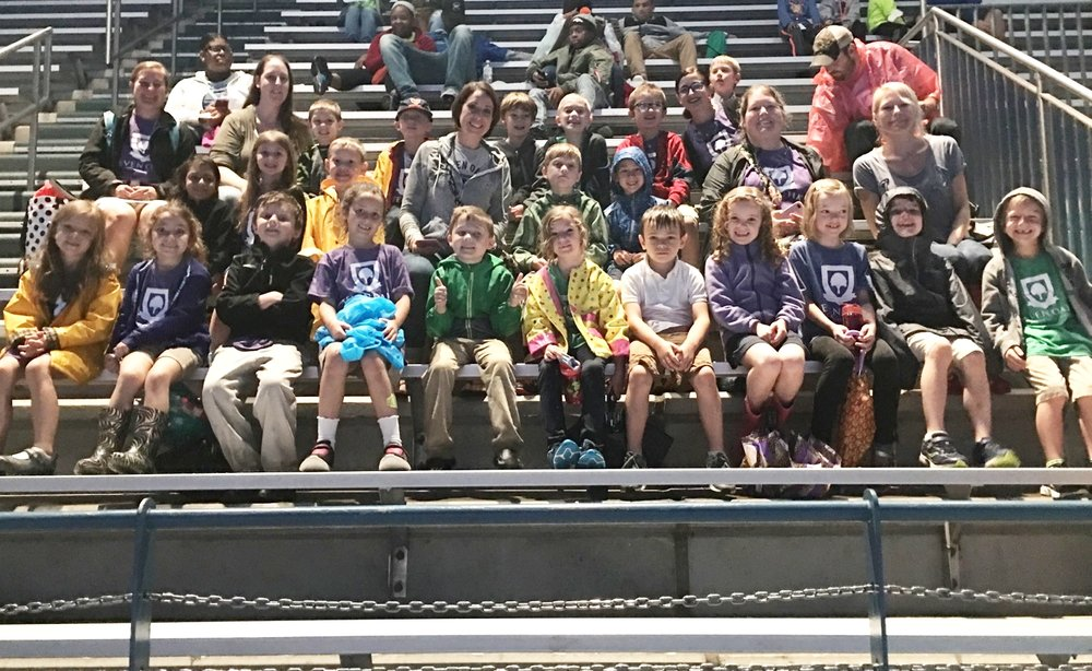 The first grade class takes a seat to watch the dolphin show.