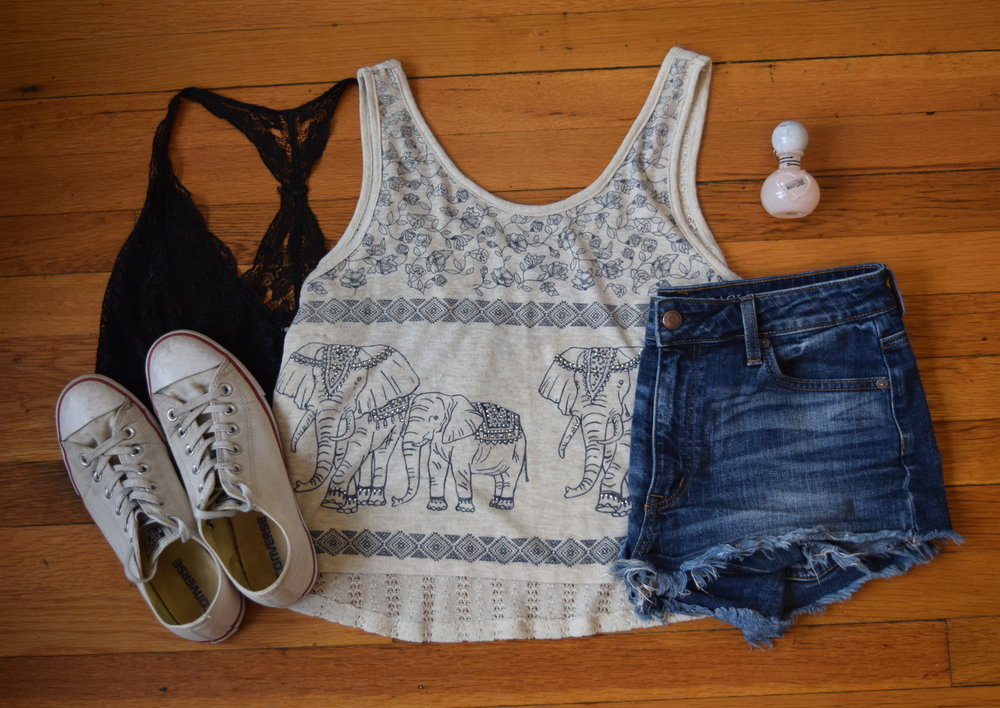 shirt (from  Mystique Boutique NYC ).  bralette .  shorts .  sneakers .  perfume .