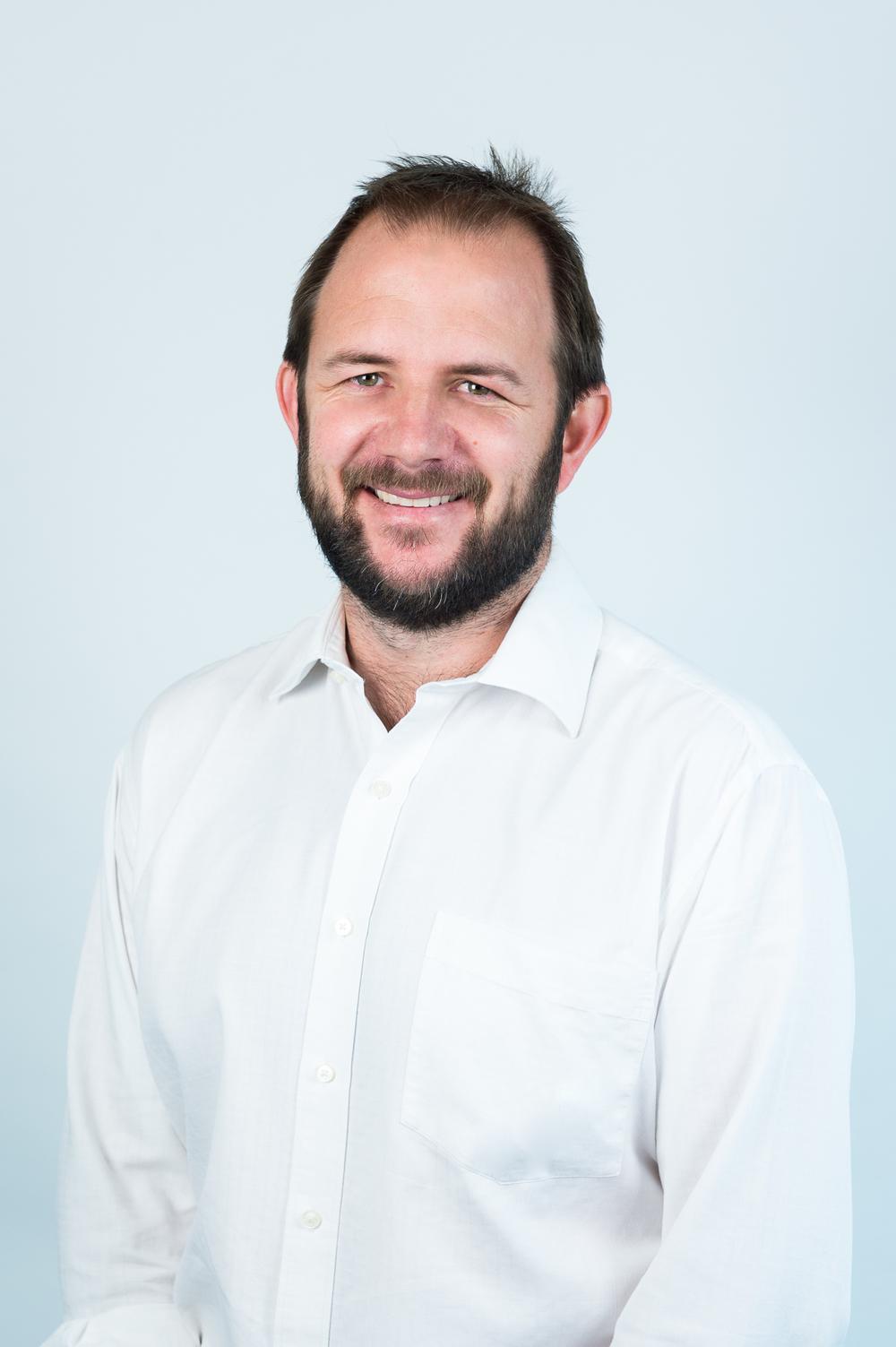 Michael Grogan, - Director