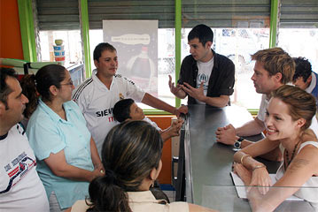 Eric served as translator during Angelina Jolie and Brad Pitt's visit with Colombian Refugee business owners in 2007