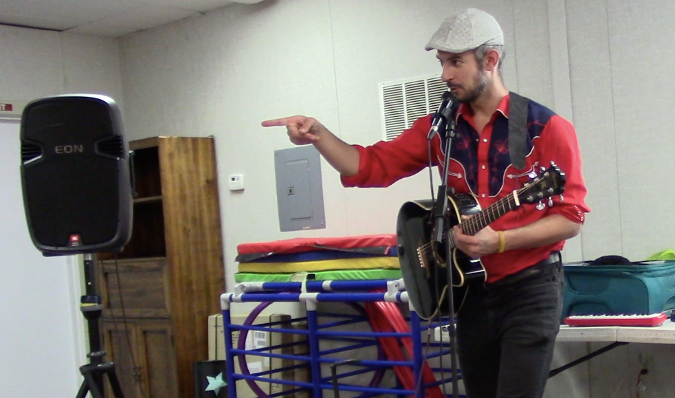 Eric performs with Bread & Roses Presents at a school in Marin for a mostly Spanish speaking audience aged 4-9