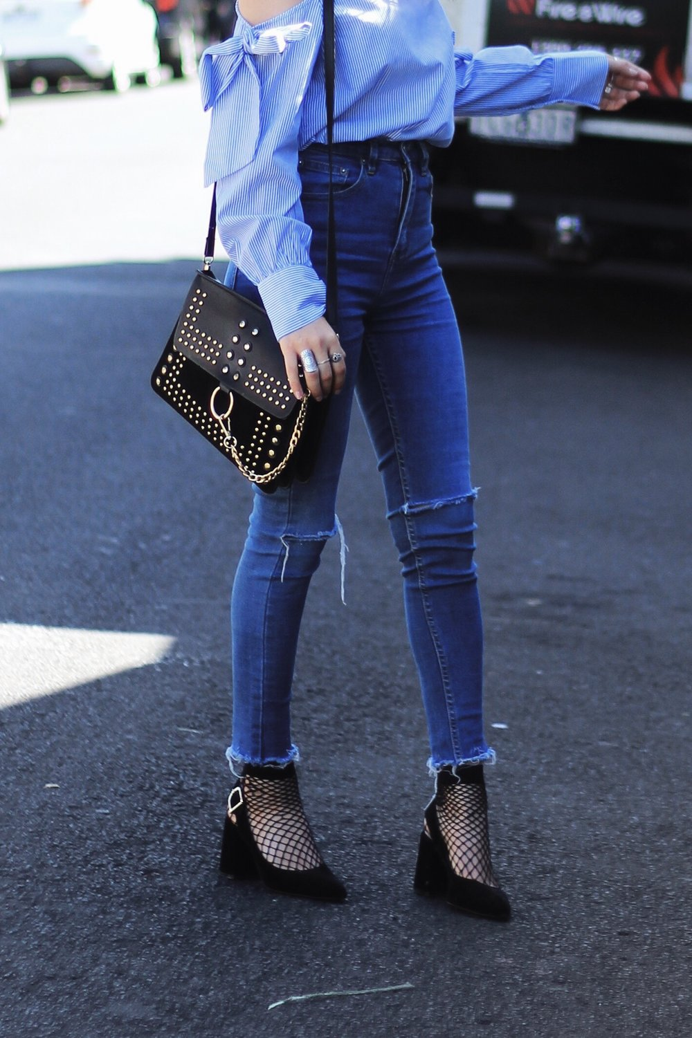 Shein, Shein bloggers, how to wear a ruffle blouse, 2017 spring fashion trends, 2017 fall winter fashion trends, melbourne fashion blog, melbourne fashion blogger, melbourne blogger, how to wear the fishnet trend, fishnet and jeans trend, cheap chanel sling back heels, ivana petrovic, ivana, wewhowander, we who wander, street style bloggers, melbourne street style, raw hems on jeans, chloe studded faye bag dupe, vegan designer bag alternatives,