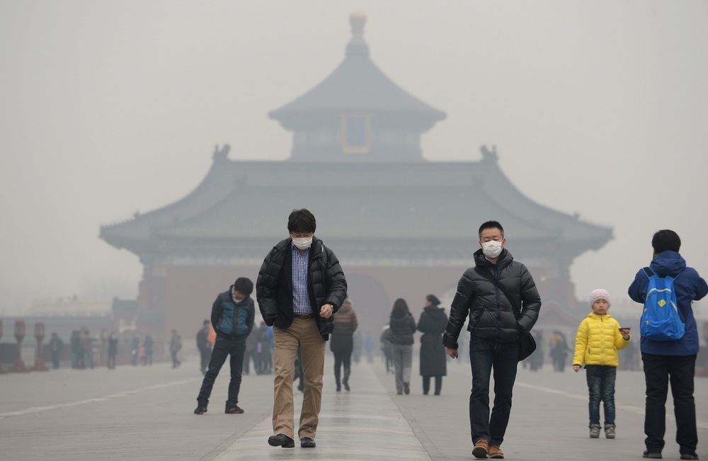 Face masks are quite common in many Asian cities and normally worn on days where there is high pollution, like this day in Beijing, China. Image Source: Getty Images