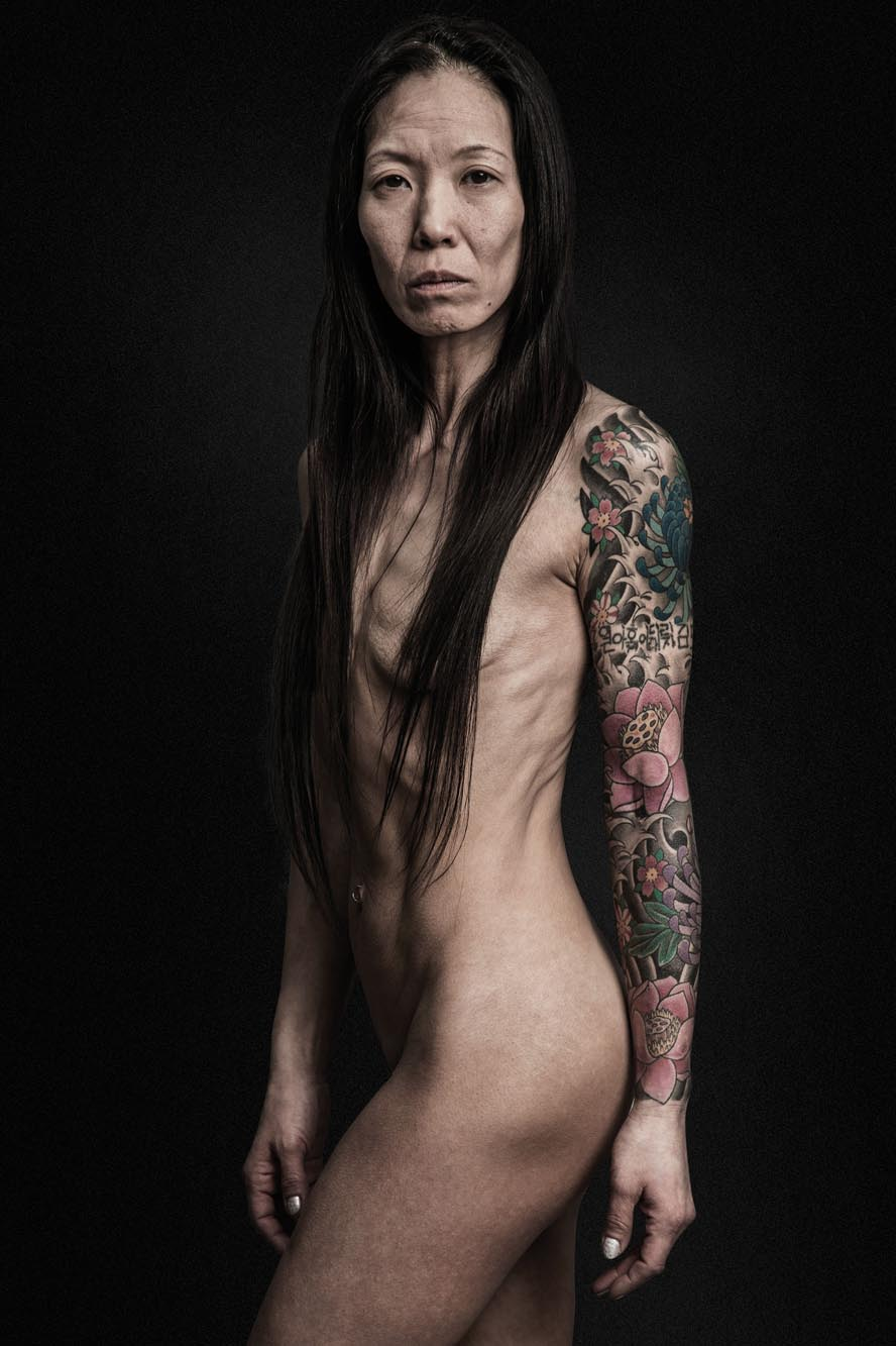 Demetrius Fordham Woman Sleeve Tattoo