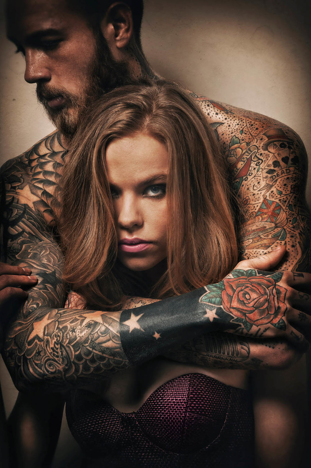 Joe Giacomet - Tattooed Man with arms around girl