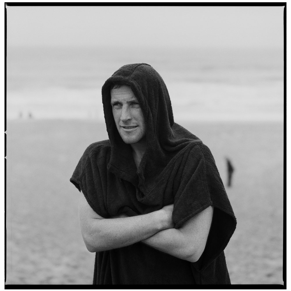 Grant Smith - The Chill man on beach with towel