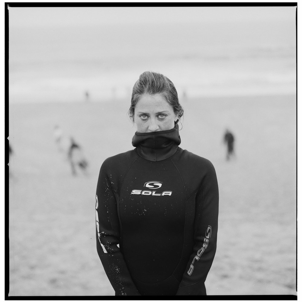 Grant Smith - Girl on beach in wet suit