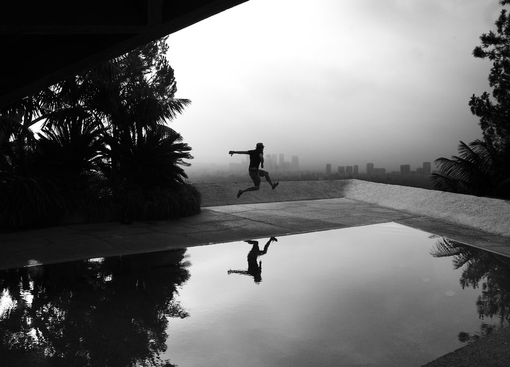 Grant Smith - Man jumping over pool