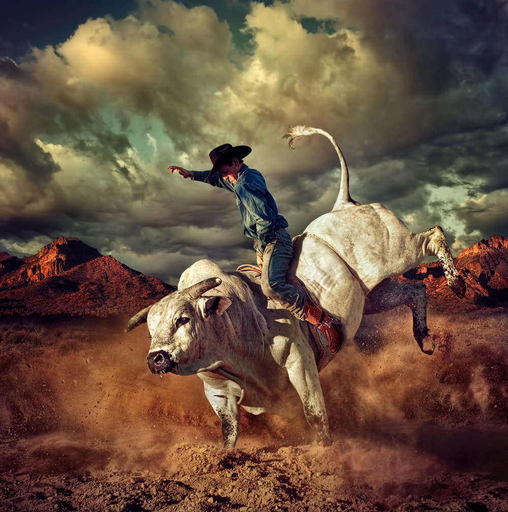 Chris Clor Cowboy riding a white bull