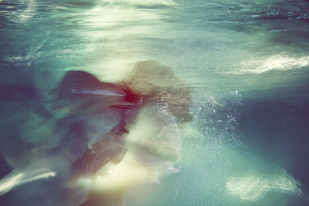 Susanne Stemmer girl underwater in red