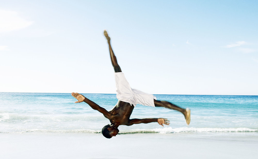 Karan Kapoor man somersaulting on beach