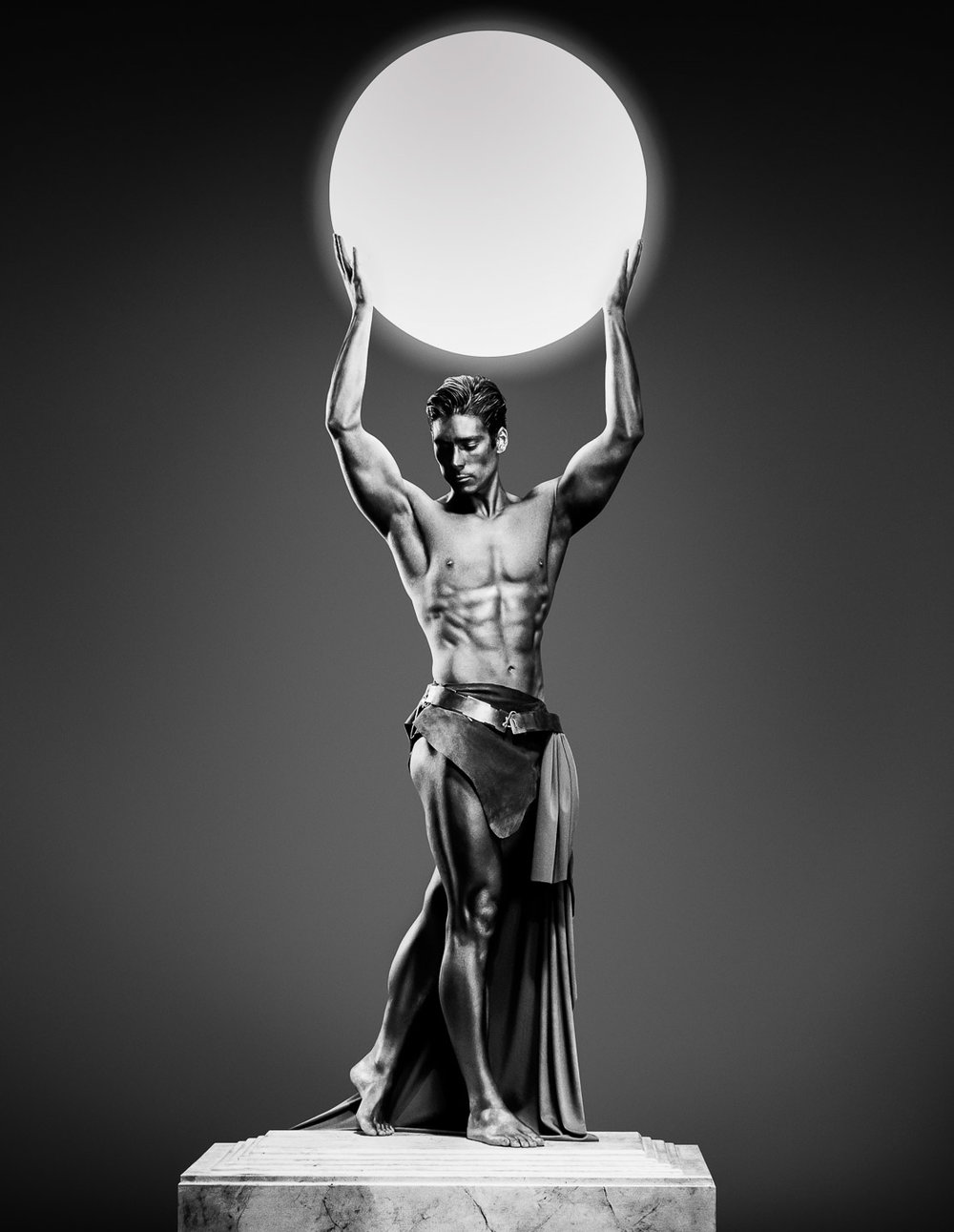 Tim Platt - iconic image of Man holding ball in plinth