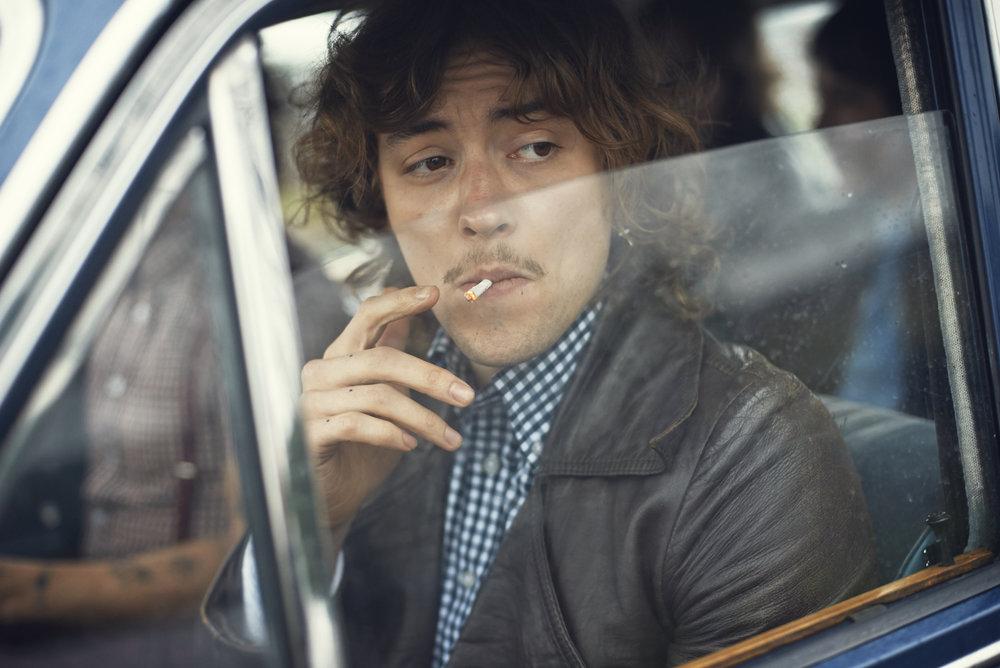 Rob Baker Ashton - guy smoking in car