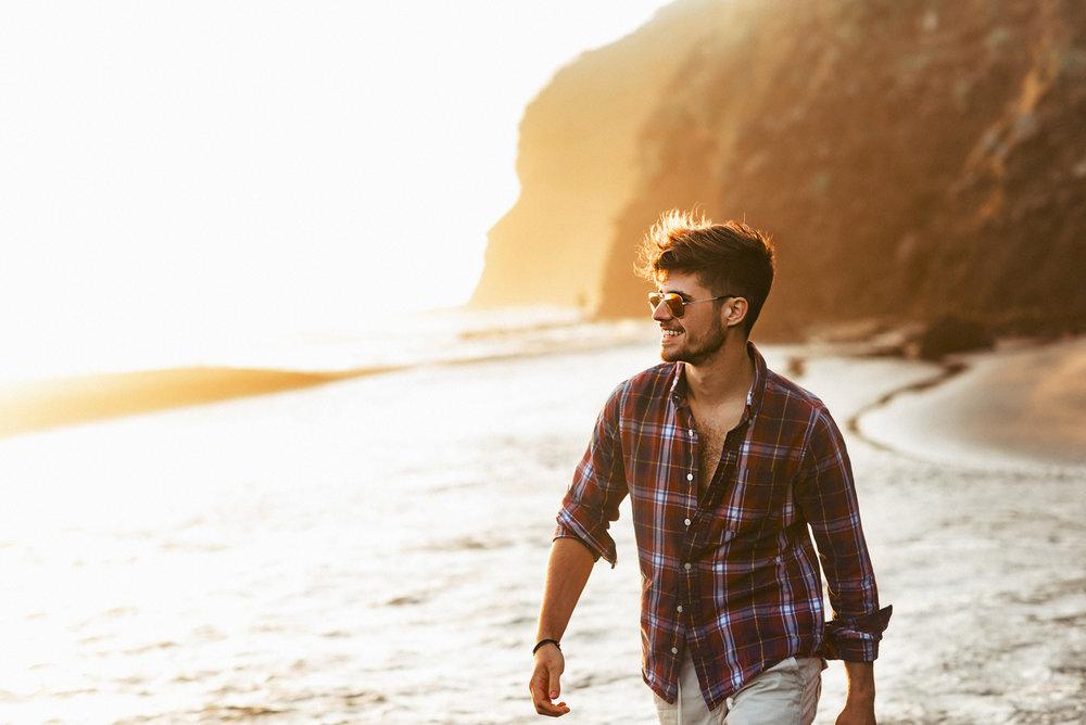 Matthew Joseph - man walking along coastline