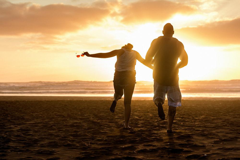 Matthew Joseph - couple on beach at sunset