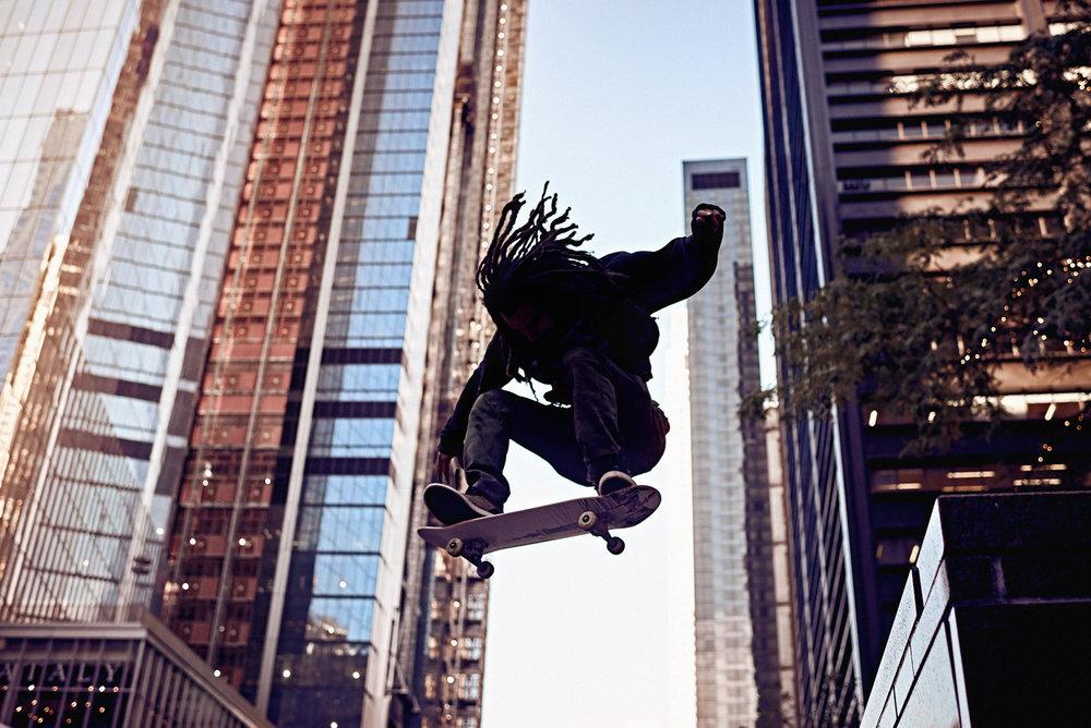 Matthew Joseph - Man on skateboard in city