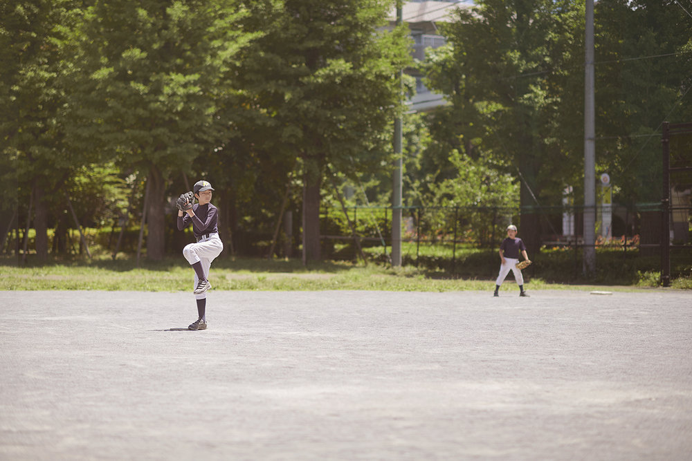 Dee Ramadan - boy playing baseball in Tokyo
