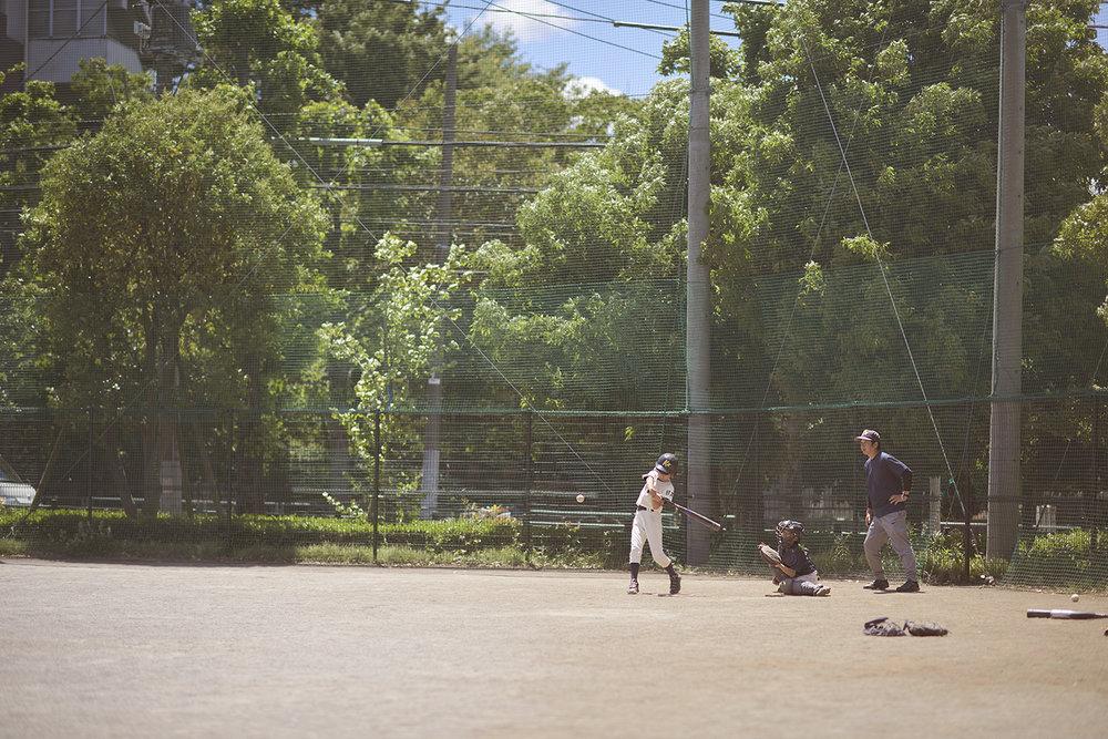 Dee Ramadan - boy fielding in baseball game in Tokyo