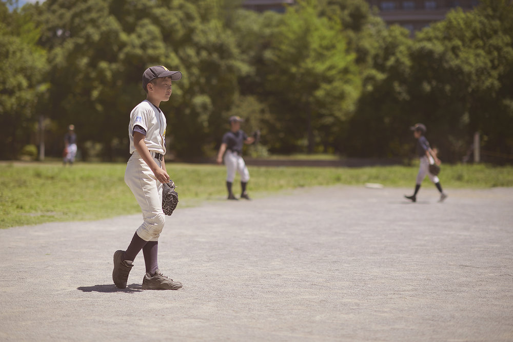 Dee Ramadan - boy fielding baseball game - Tokyo