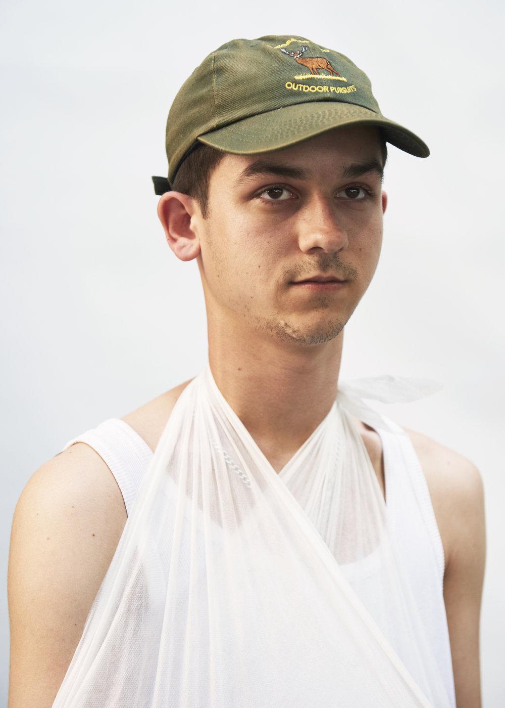 Rob Baker Ashton - Skater boy in green cap with sling