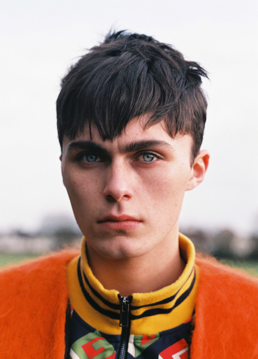 Ira Giorgetti - portrait boy with orange jacket