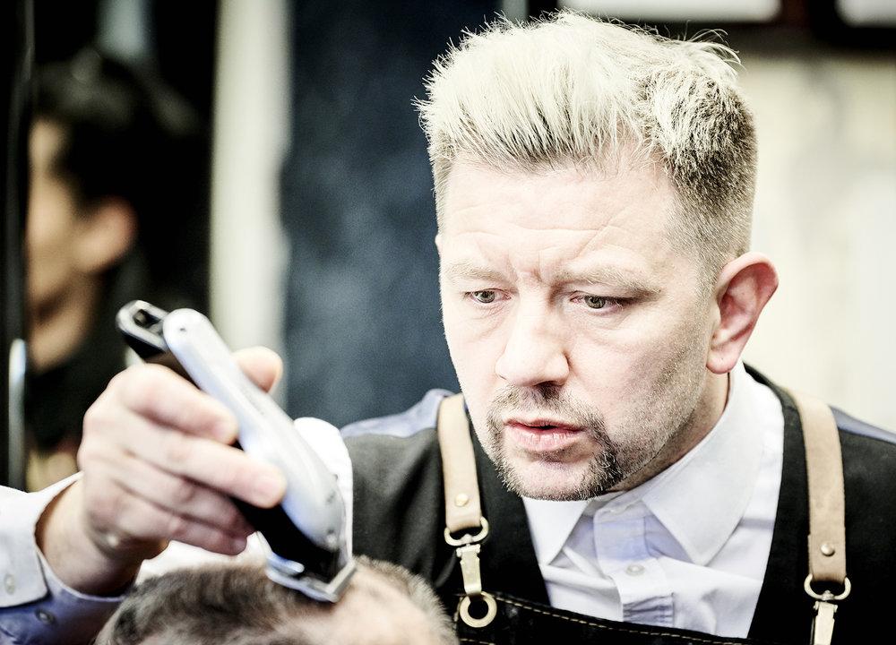 John Donoghue - Allan Stone cutting hair at his barbers shop