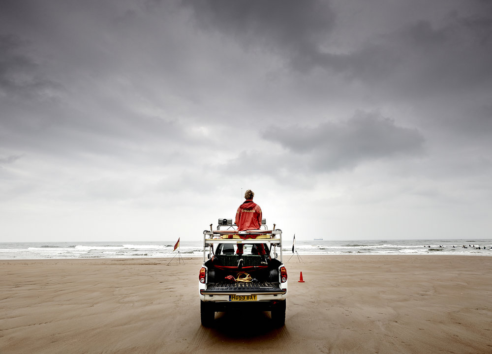 John Donoghue - liefguards on beach at dusk