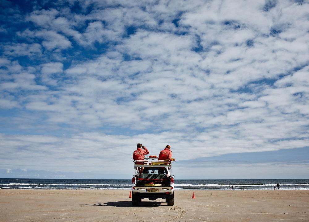 John Donohue - beach with lifeguards
