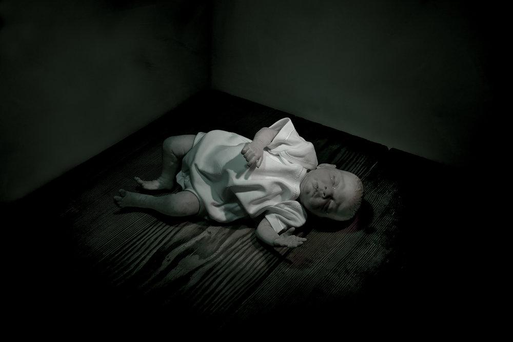 Kevin Mallett - baby doll lying down