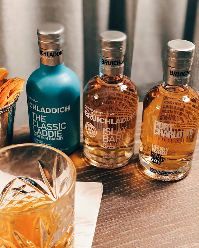 In home @Bruichladdich whisky tasting bar for this year's holiday party. • The #IslayBarley (with a massive ice cube and fresh orange peel) was my favorite out of the trip imported from a tiny island off Scotland. • Link to shop the Wee Laddie Tasting Collection (perfect gift for the holidays) in my bio.  #Sponsored