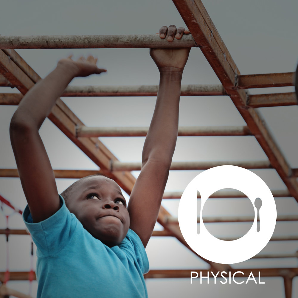 child on monkey bars in haiti