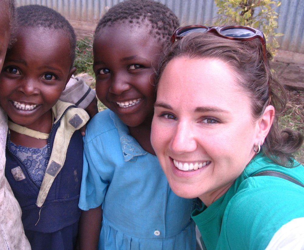 Kate with children in Kenya