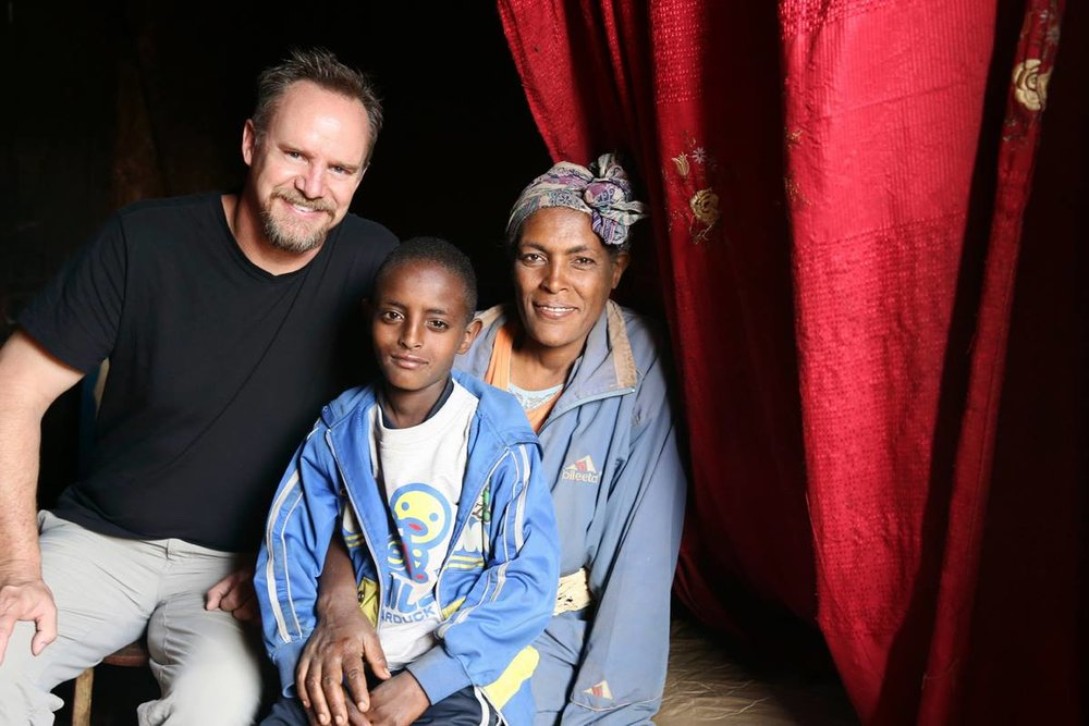 Scott with a mother and her child in Ethiopia