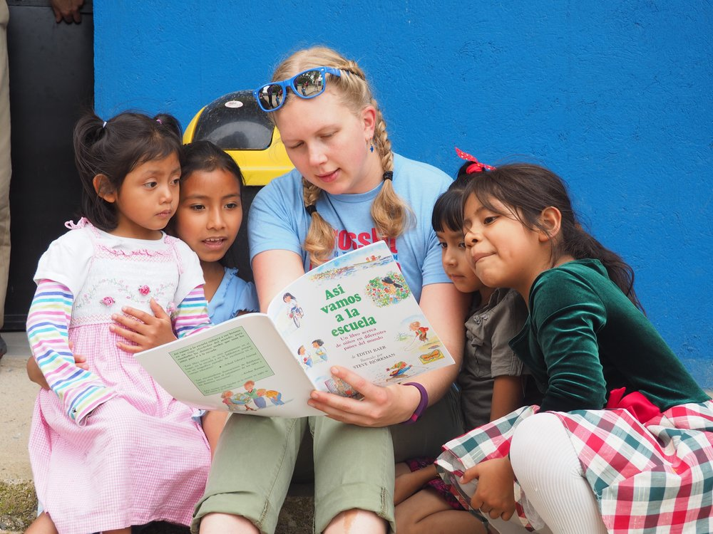 Becky reading to children at a Guatemalan church