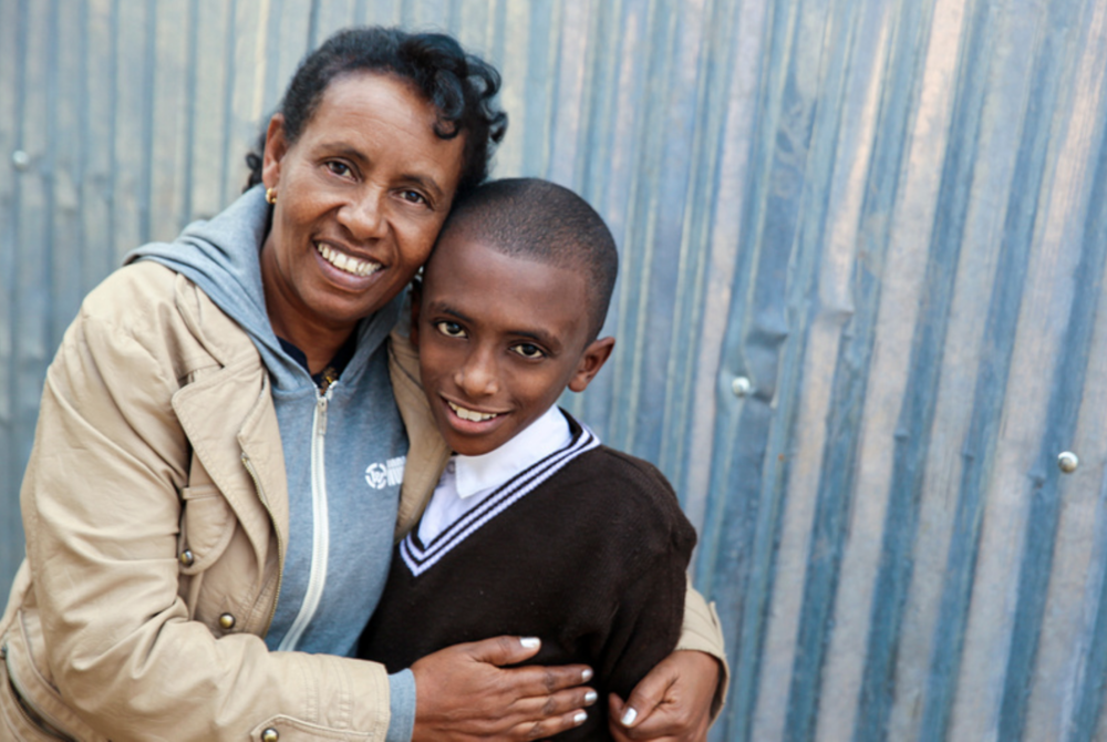Ethiopia Program Director Belginesh Tena with an Ethiopian child