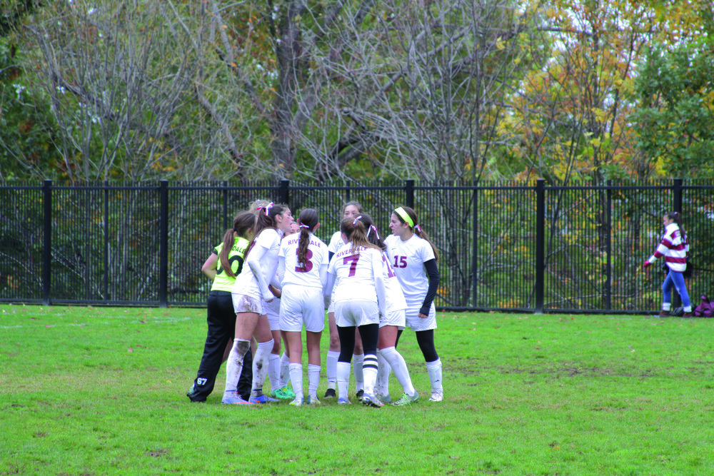 Photo courtesy of Maria Holzioanidis  The Girls' Varsity Soccer Team Cheers Right Before Their Game Playing Against Horace Mann.