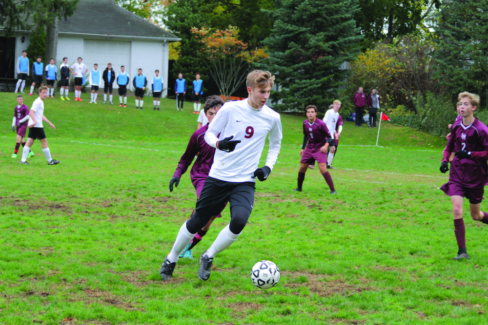 Photo Courtesy of Maria Hatzioanidis  Julian Burden Taking on Horace Mann During the Boys' Varsity Soccer Game.
