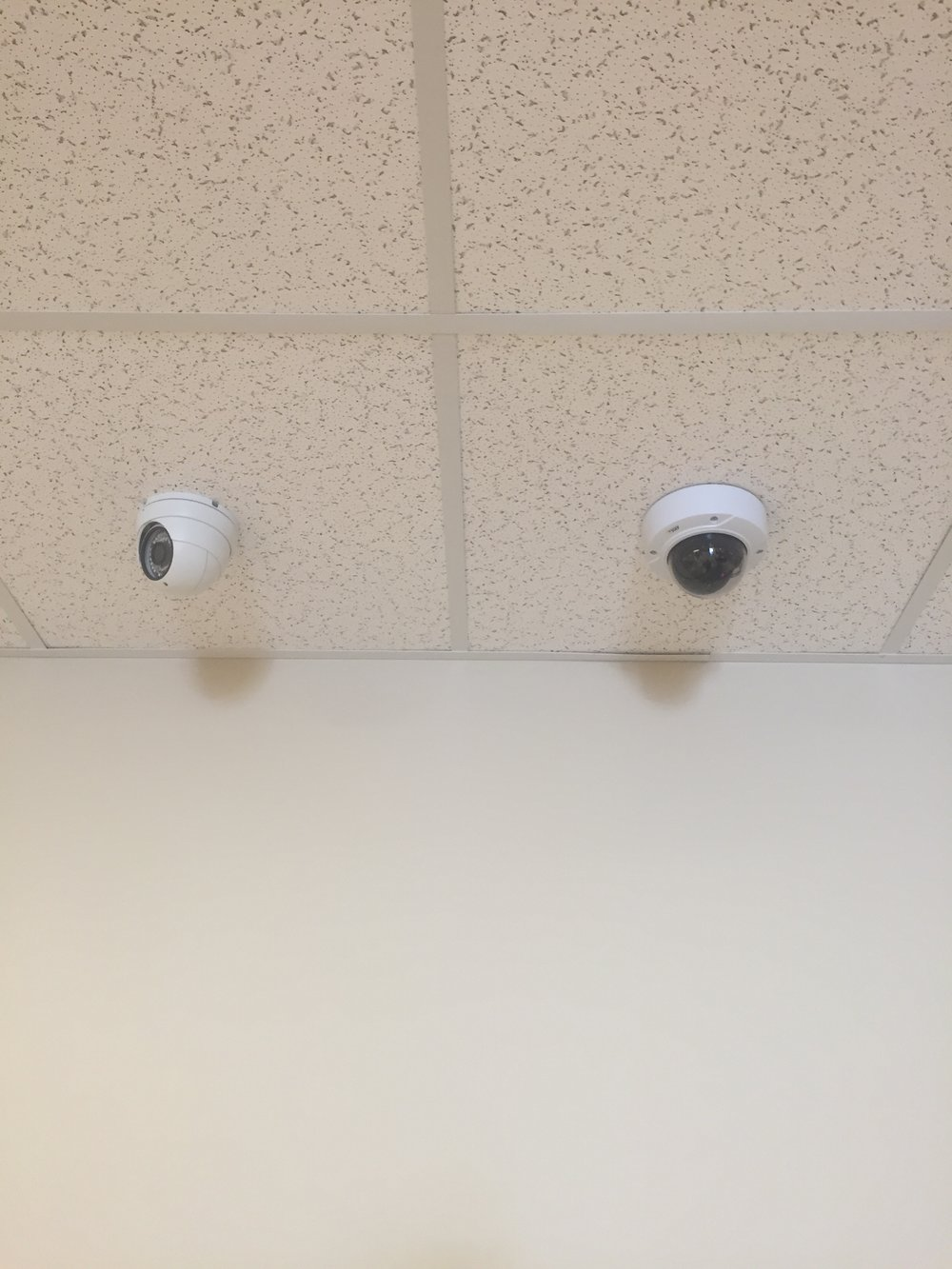 GrandStream (Left) and Axis (Right) indoor Cameras