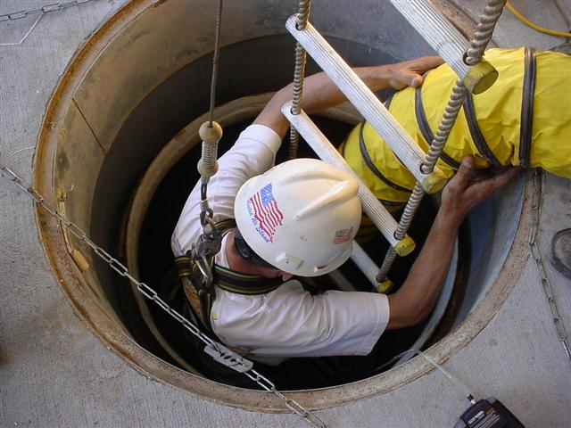 Man going into a confined space properly