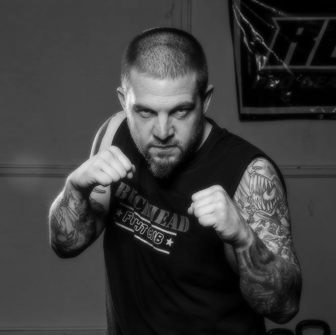Jesse Walker - is a Fit to Fight® certified Krav Maga black belt, a fitness coach, and certified Active Killer Defense, SPARology and From the Ground Up instructor. His background also includes training in Brazilian Jiu Jitsu, Judo, Wrestling, Boxing, Kali/Arnis, and Muay Thai. Jesse brings a level of excitement and expertise to his students found nowhere else in the Louisville area.