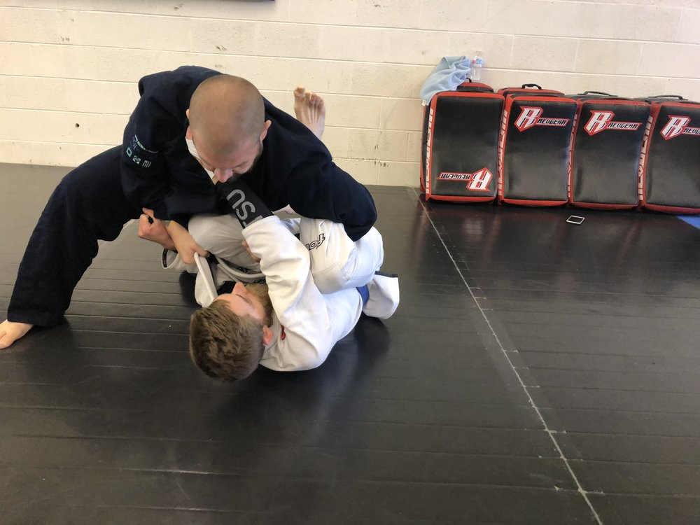 BJJ - Coming in Early 2019!Brazilian jiu-jitsu is a martial art and combat sport system that focuses on grappling and ground fighting.Our BJJ program has self defense and competition elements and is overseen by Nova Uniao 4rd Degree Black Belt Professor Marcelo Melerio.BJJ Gi is required