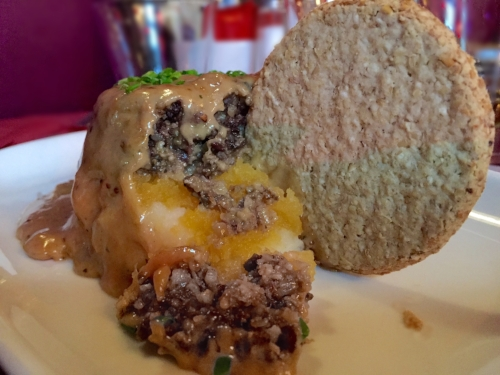 Photo Credit:  Anna Bryant   It turns out I love Haggis. Who'd've thought. It's like a meaty rice pudding. Here it is served with some mush. Haggis, neeps (mashed turnips) & tatties (mashed potatoes) can be found at most scottish restaurants.