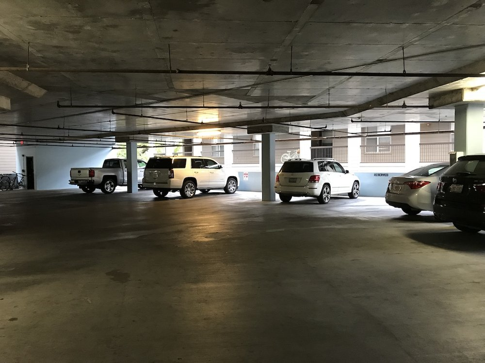 """Park in any UNMARKED space (which are easiest to find in the """"middle"""" section of the garage)."""