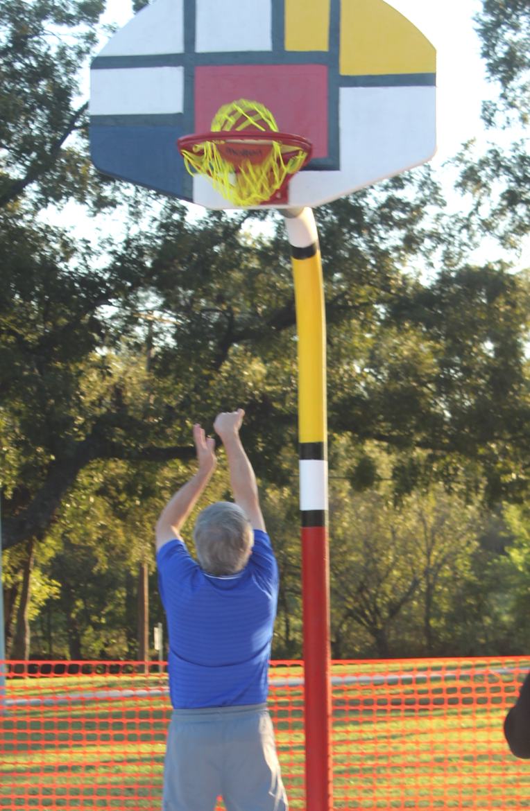 """off the board and back in…at least that's what Coach Mark Myers said it was gonna do.  Coach Myers and a handful of others got the first shot at playing a game of """"Pig"""" on the new and colorful Mondrian design basketball court at Campbell Park.  Artist Bobby Starr spent a good deal of his summer designing and painting the 2-goaler basketball court. It's    ready for action now."""