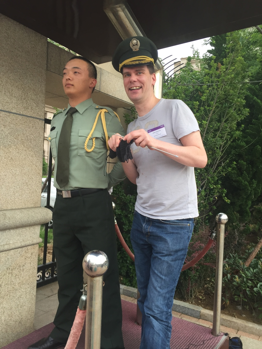 Knitting with Chinese Security Guard