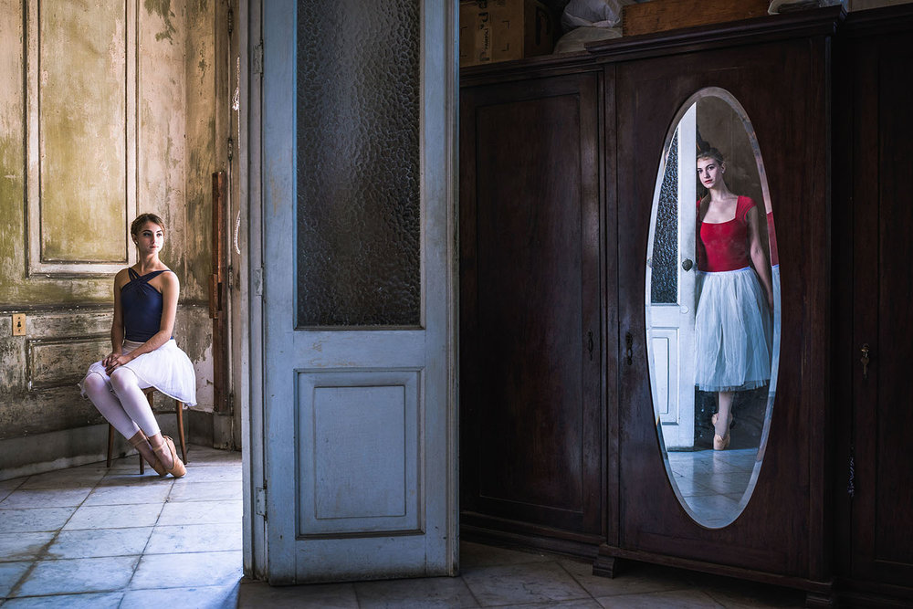 Ballerinas pose at a mirror